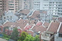 A tighter view of the rooftops from my hotel room reveals the ubiquitous laundry.