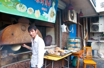 Shanghai: I bought some of his bread and was surprised that it tasted salty, and not sweet like the Indian Fry Bread that is sold in Arizona.