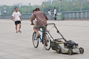 Beijing: Olympic village, just outside of the Bird's Nest, on his way to another job.