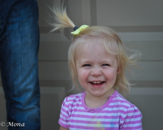 Covered in chalk dust, she laughs out loud as Daddy stands by.