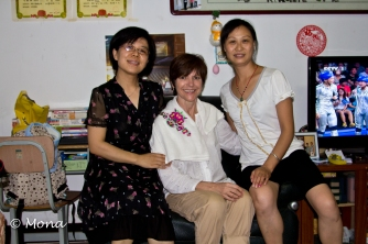 Here I am (the white American in the middle) with our colleague's sister (on left) and his wife. They gave me the embroidered cloth that is on my shoulder. They said it's to protect my clothing, but I think it's too pretty for that purpose and I'll wear it on a special occasion.