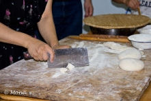 The rope of dough is chopped into small pieces.