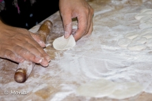 Shaping the very thin dough into circles.